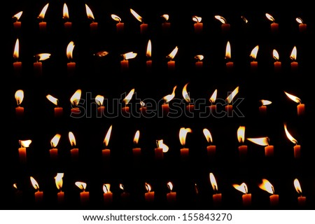 Set of candle light isolated on black background - stock photo