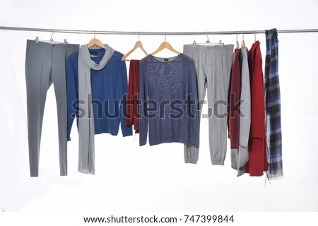 Set of casual clothes shirts ,suit, coat ,scarf, trousers,on hangers