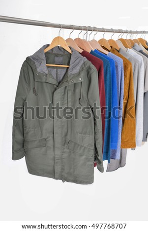 Set of casual men's clothes shirts , coat, jacket, suit on hangers