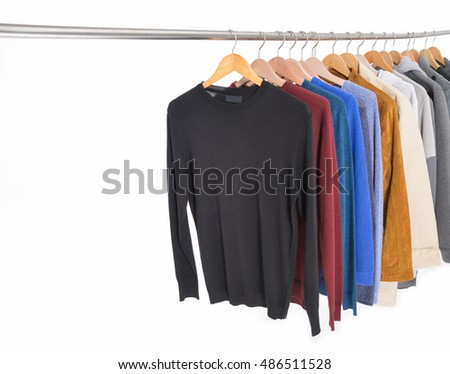 Set of casual men's clothes shirts , coat on hangers