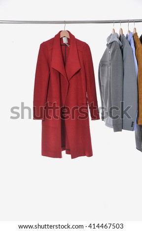 Set of casual men's clothes shirts ,red coat on hangers