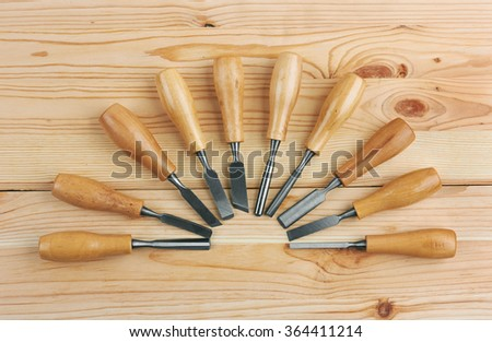 Set of Chisels on wooden background - stock photo