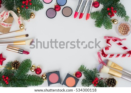 Set of Christmas make up cosmetics products frame with  copy space, top view