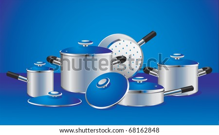 set of chrome-plated pans with blue lids - stock photo