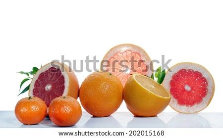 set of citrus fruit on white background - stock photo