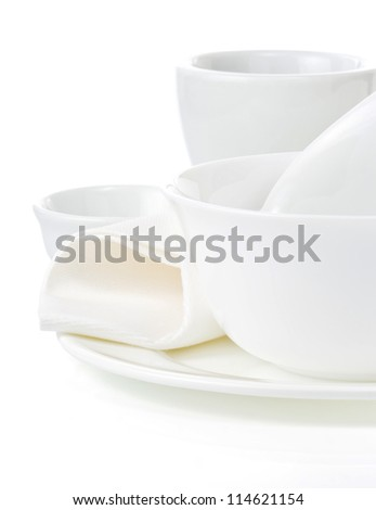 set of clean dishes isolated on white background
