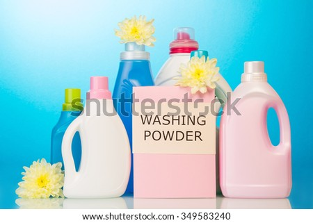 Set of cleaning products isolated on blue background