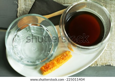 set of coffee,Overhead view of a freshly brewed of hot black coffee americano,drinking water and biscotti  - stock photo