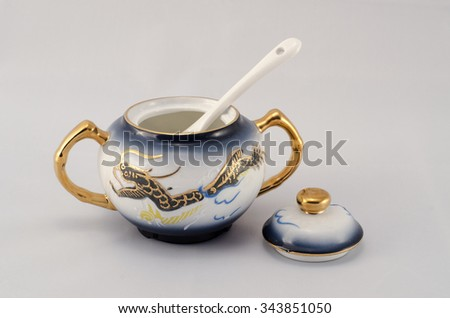 Set of coffee. Sugar bowl with spoon. Blue-eyed, golden dragon pattern. - stock photo