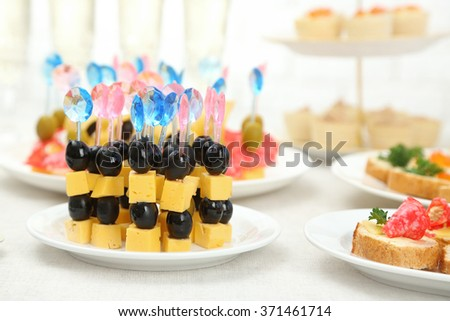 Set of cold snacks and canape, closeup - stock photo