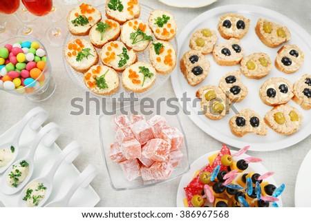 Set of cold snacks, canape and dessert, closeup - stock photo