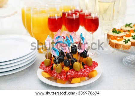Set of cold snacks, canape, beverages, closeup - stock photo