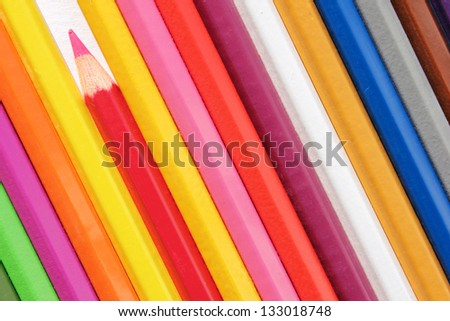 Set of color pencils against a white background. Suitable for an abstract background.