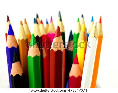 Set of color pencils on white background, macro, shallow depth of field, focus on brown pencil