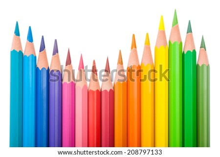 set of color pencils wave-shaped on white background