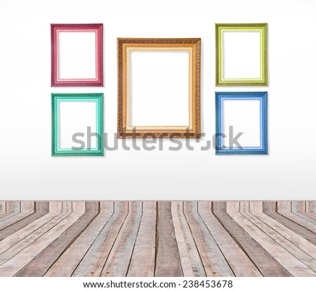 Set of color vintage picture frames on the wall inside wooden room  - stock photo