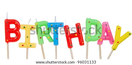 Set of colored birthday candles isolated on white