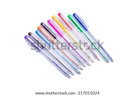 set of colored gel pens with ink on a white background - stock photo