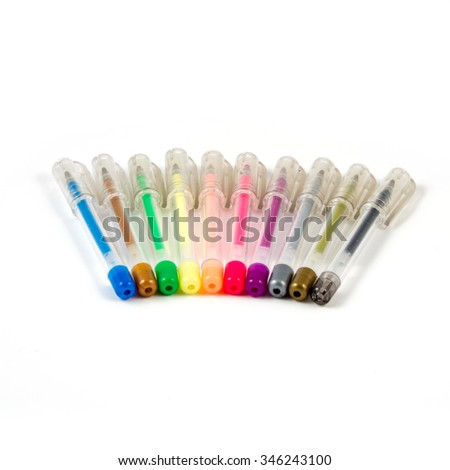 set of colored gel pens with ink on a white background. - stock photo