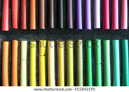 Set of colored pastel crayons for drawing on paper. Pattern.