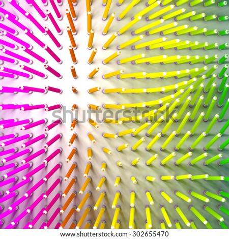 Set of colored pencil. Pencils are standing and aligned following force field and using rainbow colors. Aerial view. - stock photo