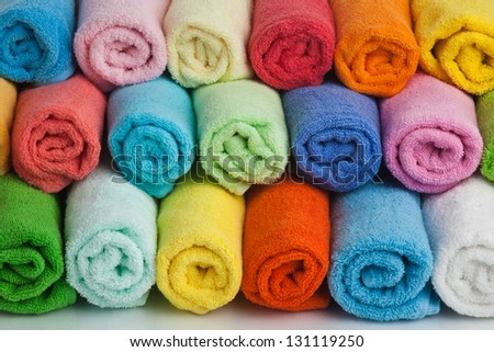 Set of colored towels on white background. - stock photo