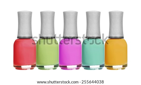 set of colorful bright nail polishes isolated on white background