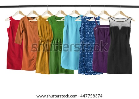 Set of colorful dresses on clothes racks isolated over white