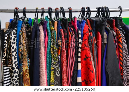 Set of colorful female fashion clothing on hanging  - stock photo