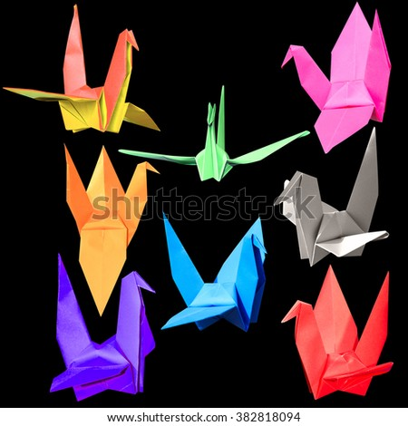 set of colorful many origami paper birds isolated on black background with clipping path - stock photo