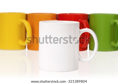 Set of colorful mugs for coffee or tea, isolated on white background - stock photo
