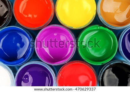 set of colorful paints, top view for backgrounds