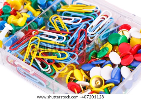 Set of colorful pins and clips closeup picture. - stock photo