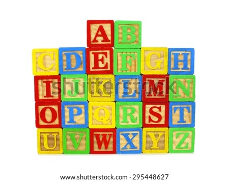 Set of colorful toy alphabet wooden blocks stacked on a white background