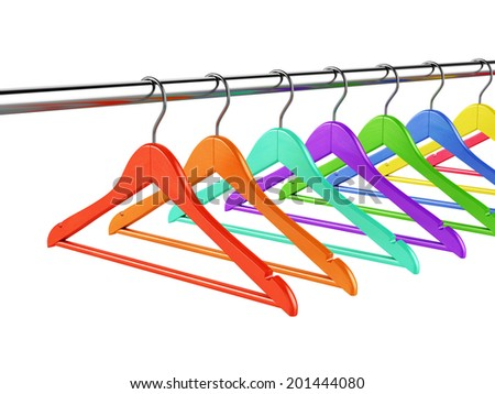 Set of colorful wooden hangers on clothes rail over white background - stock photo