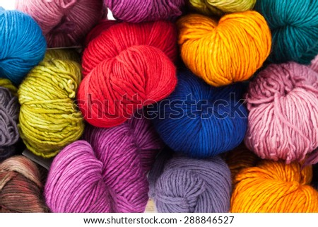 Set of colorful wool yarn balls. Hanks are set out in a pile.