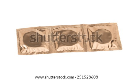 Set of condoms in golden packing isolated on white background