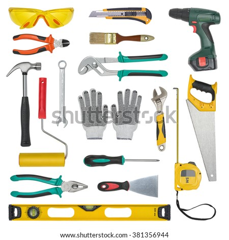 Set of construction tools isolated on a white background. Level, saw, glasses, tape measure, wrench, spanner, paint roll, hammer, cutter, pliers. - stock photo