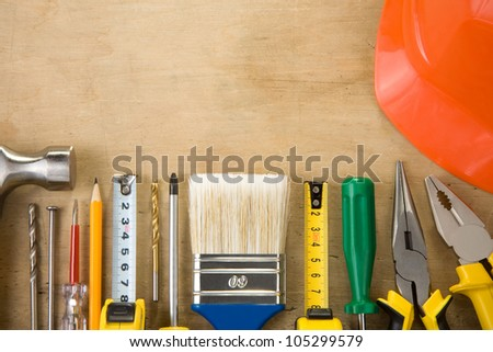 set of construction tools on wood texture background