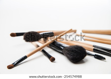 Set of cosmetic brushes. Makeup brushes on a white background - stock photo