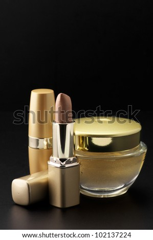 Set of cosmetic products on black background.