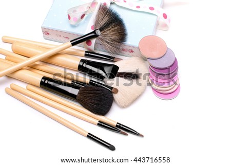 set of cosmetics: makeup brushes and multicolored eyeshadow