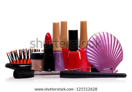 Set of cosmetics - nail polish, small mirror, comb and lipstick isolated on white background - stock photo