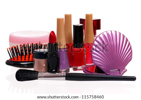 Set of cosmetics - nail polish, small mirror, comb and lipstick on white background - stock photo