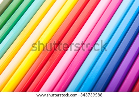 Set of crayons in a row forming the color spectrum