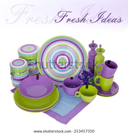 Set of crockery | tableware | colorful | mottled | still life | dishes | isolated | green | purple - stock photo