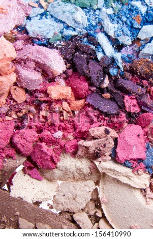 set of crushed eyeshadows as a background - stock photo