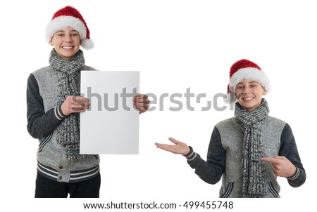 Set of cute teenager boy in gray sweater and christmas hat holding paper over white isolated background, half body