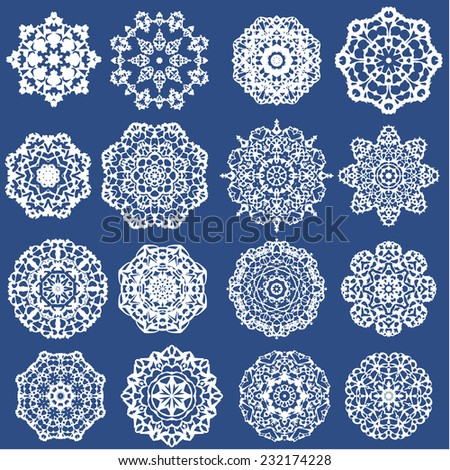 Set of Decorative paper snowflakes. White on blue background. Raster version - stock photo