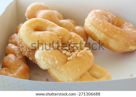 Set of delicious donut in paper box - stock photo